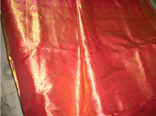 Kanjeevaram saree with gold, peach, and pink shades.