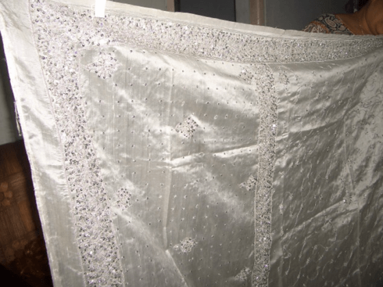 heavily sequined white virgin raw silk saree