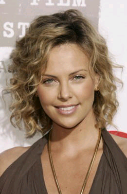 medium curly hair style Charlize Theron