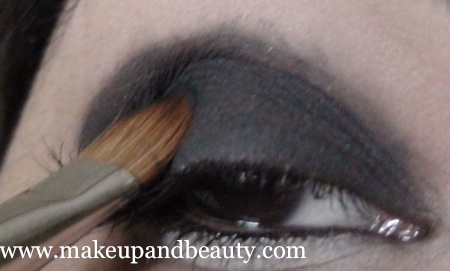 Pat the black eye shadow on lids