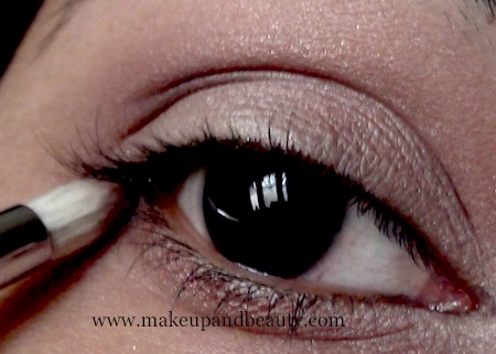 Plum eye shadow on outer corner
