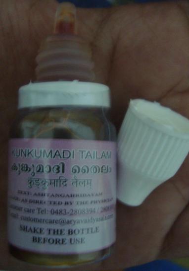 kumkumadi thailam bottle