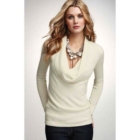 Wearing a necklace with a cowl-neck sweater dress can be tricky since the neckline has such a bold, distinctive look. Instead of wearing a necklace that competes with the cowl neck, choose other jewelry options that can spice up your look.