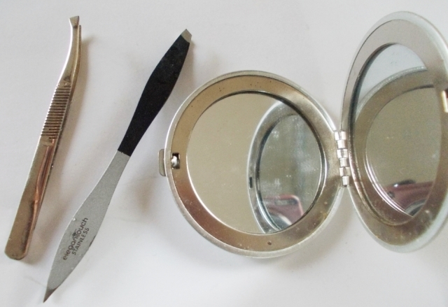 tweezers and double sided mirror
