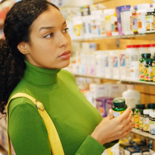 rotato woman shopping for vitamins Vitamins for Hair Growth