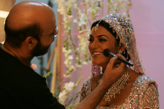 Sushmita Sen doing makeup