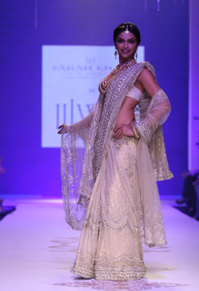 Deepika Padukone walking the ramp in saree