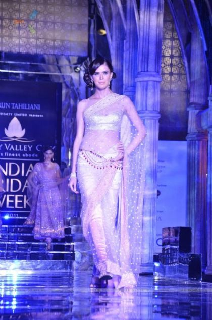 Model walks the ramp for Tarun Tahiliani show at Aamby Valley Fashion week. .