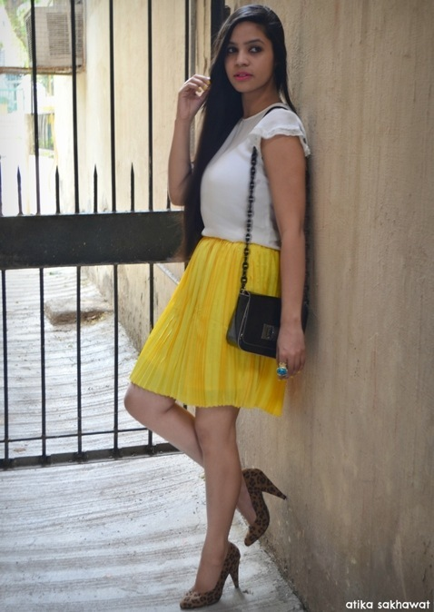 of the day yellow pleated skirt